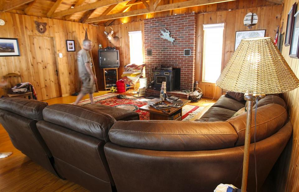Abare's cottage has knotty-pine walls, a sleeping loft, and a bathroom with modern plumbing.
